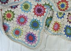 I think this would be a lovely little baby blanket for a little girl.  Pattern here: http://www.ravelry.com/patterns/library/flowers-in-the-snow