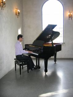 Melbourne pianist Calvin Leung performing on a beautiful grand piano.
