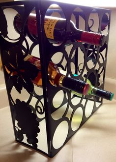 Custom made wine rack that holds 16 bottles cut from a cnc plasma cutter and powdercoated 16inx16inx7in