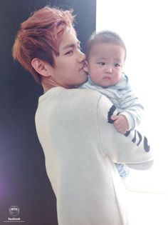 V is so cute holding that precious baby like the baby is his kid