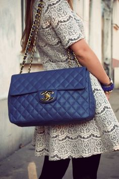 The Chanel bag is so chic, and that dress is a total bonus.