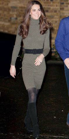 ...in a belted dress by Ralph Lauren and knee-high boots by Rumba