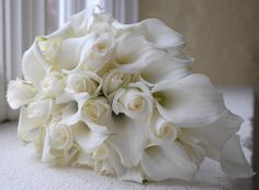 White bouquet. Cala lilies and roses