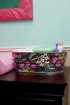 Decoupage fabric on galvanized bucket. Clever!