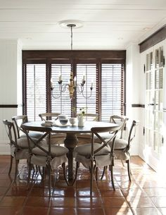 Dark wood shutters add contrast to create a focal point in this otherwise white-washed room.
