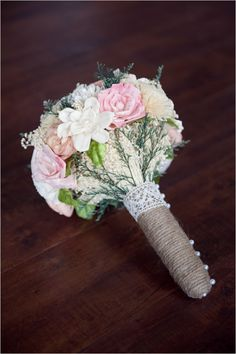 handmade burlap wedding bouquet #vintagewedding #bouquet #rusticwedding http://www.weddingchicks.com/2013/10/29/bookworm-wedding/