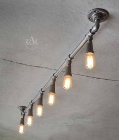 Tips For Improving The Look And Quality Of Your Home through Industrial Lighting Making repairs or improvements to your family home can be a scary undertaking if you don't have much experience in doing it. Industrial Ceiling Lights, Industrial Style Lighting, Industrial Light Fixtures, Interior Lighting, Lighting Design, Ceiling Lighting, Track Lighting Fixtures, Lighting Ideas, Club Lighting