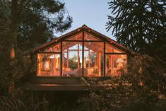 Artist Peter McClaren used recycled materials, from telephone poles and scaffolding to roofing tin, to create this glass-box of a retreat on his family's property in Scotland.