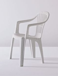 Punctured Monobloc Plastic Chair by Tina Roeder - Chair Blog