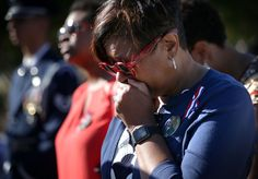 Sept. 11 victims' relatives marked the anniversary of the terror attacks Friday in a subdued gathering at ground zero, saying their determination to commemorate their loss publicly hadn't dimmed even as 14 years have passed and crowds at the ceremony have thinned.