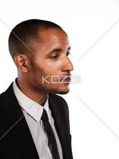 close-up of a young serious businessman. - Close-up of a young serious businessman over white background, Model: Kareem Duhaney