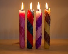 Make a set of festive, striped rolled beeswax candles!