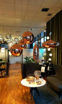 Tom Dixon's squashed/stretched copper sphere shade display at Roomstore's flagship store Copenhagen