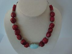Red Coral nuggets with bali silver and antiqued silver pewter spacers and one piece of turquoise (magnesite) and oxidized sterling chain. Shown on my RubyLane website. Will be making more!