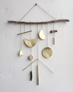 "Brass geometric wall hanging + geometric mobile // ""Lucent"" // Ready to ship by ELECTRICSUNCREATIVES on Etsy https://www.etsy.com/listing/249293210/brass-geometric-wall-hanging-geometric"