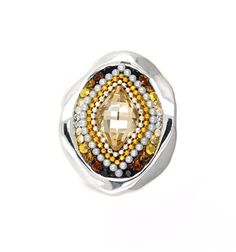 Shimmer and spice and everything nice—that's what makes this stunning earth tone ring so special. At the center is a diamond-shaped pale amber Swarovski crys...