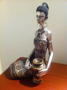 Hey, I found this really awesome Etsy listing at https://www.etsy.com/listing/168922366/silver-african-woman-sculpture-masai