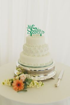 Cake toppers are a great way of personalising your cake - even one with your name on it. Photo by Benjamin Stuart Photography #weddingphotography #weddingcake #summerwedding