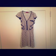 Beige spotted dress Beige dress with black spots. Excellent condition - never been worn. AKIRA Dresses Midi