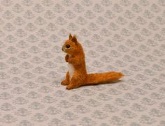 Linda Master, Miracle Chicken, IGMA fellow - hand carved and hand furred squirrel; sold on ebay for $32