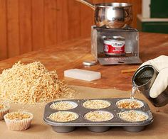Pack sawdust into paper muffin cups, above, or a cardboard egg carton. Melt paraffin wax or old candles in a double boiler, pour over the sawdust and allow to cool. Slow-burning when lit, these hotcakes make great starters for a fireplace or campfire.