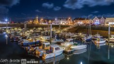 On the border ..... Vale & St Sampson to be precise. A becalmed St Sampson Harbour, just the occasional shimmer in the moonlight #Guernsey #GreatThings  Link to the whole collection of 'Georgie's Pic Of The Day' :-http://chrisgeorge.dphoto.com/#/album/4daaes  Picture Ref: 24_09_15 — in Guernsey.