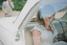A beautiful photo of bride Melanie Soucy arriving at her garden party wedding. Photo by Sean McGrath.