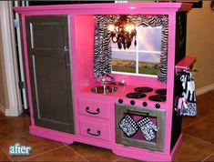 Hands down most creative repurposing for furniture that I've ever seen!  Turning an entertainment center into a play kitchen!  And a hot pink and zebra one at that!!
