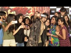 Varun Dhawan surrounded by his CRAZY FEMALE FANS for a selfie.