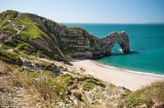 Durdle Door, a limestone arch on the Jurassic Coast near Lulworth, Dorset, is a popular spot for holidaymakers