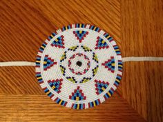 """Northern style bustle medallion. 4 1/4"""". Reinforced backing. Rolled beaded edge work. 11/0 cuts. December 2014 Scott Sutton"""