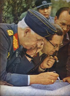 In this color print, Field Marshal Erich von Manstein, perhaps Nazi Germany's best strategist, pores over the map along with General of Panzers Hermann Breith in preparation of Operation Citadel which was to take place in July 1943. At the time (May 1943), von Manstein was commanding Army Group South and General Breith the 3.Panzer Corps.
