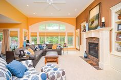 Traditional Living Room with Carpet, Ceiling fan, metal fireplace, Wainscoting, Crown molding, High ceiling