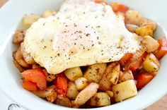 Whole 30 Friendly Southwestern Breakfast Bowl Recipe Breakfast and Brunch with medium potatoes, onions, red pepper, bacon, cooked chicken breasts, olive oil, salt, paprika, cayenne pepper, garlic powder, onion powder, chili powder, cumin, eggs, cracked black pepper