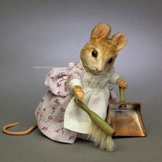 """R. John Wright Dolls - Hunca Munca™ Mohair, 3"""" tall, jointed arms and neck, glass pupil eyes; resin hands/feet; leather tail; custom printed dress w/apron; custom made broom and dustpan. Date of Release: 2007 Limited Edition: 500."""