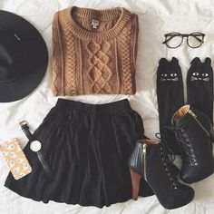 cable knit sweater/pleated short skirt/black platform booties/black frame glasses/tall socks