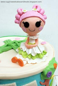 http://www.sugarsweetcakesandtreats.blogspot.com/2012/06/lalaloopsy-cake-cake-pops.html