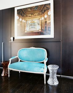 French Furniture - A blue settee and a pair of faceted hourglass tables against gray walls