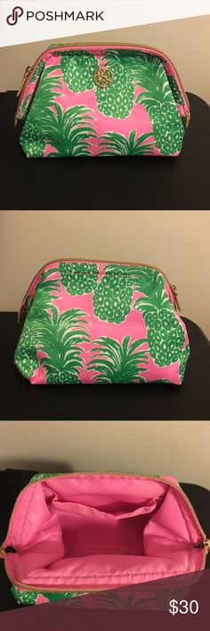 "Lilly Pulitzer Waterside Cosmetic Case A gently used Lilly Pulitzer cosmetic case in the print Flamenco. Measures approx. 7 3/4"" W x 5 1/4"" H x 5 1/2"" D. Material: sateen polyester. Small black stains on the interior (picture 4). Lilly Pulitzer Accessories"