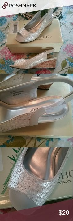 Annie's Pearl White wedges a shoes, NIB This is another pair of shoes I can't wear since my foot surgery and cleaning out closet. Never worn. They even have tissues still around buckle on strap, the way they came. Size 8m. Really comfy too. Just wished I could wear them. Will go with about anything. If you have any questions please feel free to contact me and I'll get back to you as soon as possible. Thank you for looking and have a blessed day. annie's Shoes
