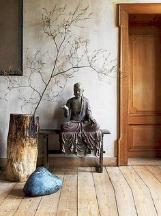 The Zen Simplicity of a single branch…k..the scale is also i keeping with the large vessel, stone and sculpture.  Nature is the best artist.