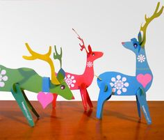 Get crafty with these gorgeous paper reindeers!    Create a fantastic festive centre piece or mantle piece decoration with this PDF template.    The