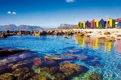 St. James Beach in Cape Town with its colorful changing rooms and tidal pool.