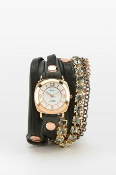 Wrap style leather watch adorned with crystals and chains, from La Mer. #urbanoutfitters