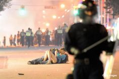 was the background on my computer for months... an Australian man runs to his girlfriend after she was knocked down in a riot