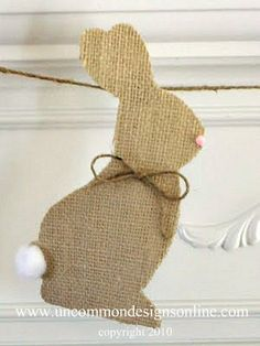 Easter is fast approaching, and Trish and I wanted to share a little project with you from a few years ago… This simple, little burlap banner is just the perfect touch to your Spring and Easter decor! These little bunny silhouettes are just too cute! We simply cut them out of burlap,added a pom pom nose and tail, a sweet twine bow and glued them
