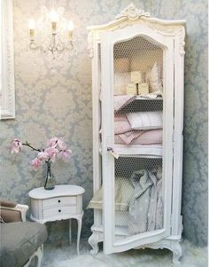 french provincial armoire - perfect in a washroom for linens