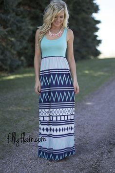 """Spring Fling Maxi in Mint - This adorable form fitting sleeveless maxi in mint with elastic waist band and the perfect amount of print in the skirt to make is the ultimate addition to your wardrobe!  Bust in Small 28"""" Medium 30"""" Large 32"""" Waist in Small 24"""" Medium 26"""" Large 28"""" Length in Small 56"""" Medium 56.5"""" Large 57"""" 95% Polyester 5% Spandex Hand Wash Cold Made in U.S.A. Model is size 4 in a small. Small 0/4, Medium 6/8, Large 10/12"""