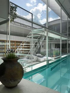 Gayton Road Residence by Richard Paxton...custom glass pool and retractable roof