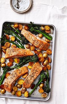 Sheet Pan Salmon With Potatoes and Broccolini Not only does this simple salmon and veggie dinner come together on one sheet pan it keeps your shopping list shorta double. Quick Healthy Meals, Healthy Dinner Recipes, Cooking Recipes, Simple Healthy Recipes, Healthy Salmon Recipes, Tasty Meals, Cooking Games, Fish Recipes, Seafood Recipes